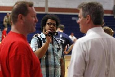 Democratic Party tracker Martin Geldhof videotaped Senator Scott Brown at Newton South High School.